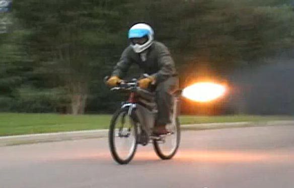 Tim flies down the raod on his rocket-propelled bike