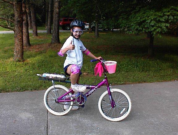 Sarah give the rocket bike a thumbs-up