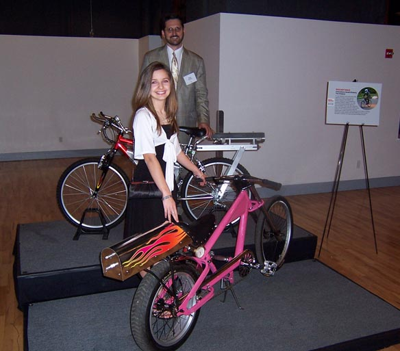 Tim and Sarah Pickes with the rocket bikes they built