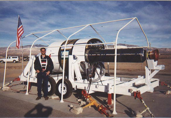 Tim Pickens with rocket motor used to propell SpaceShipOne